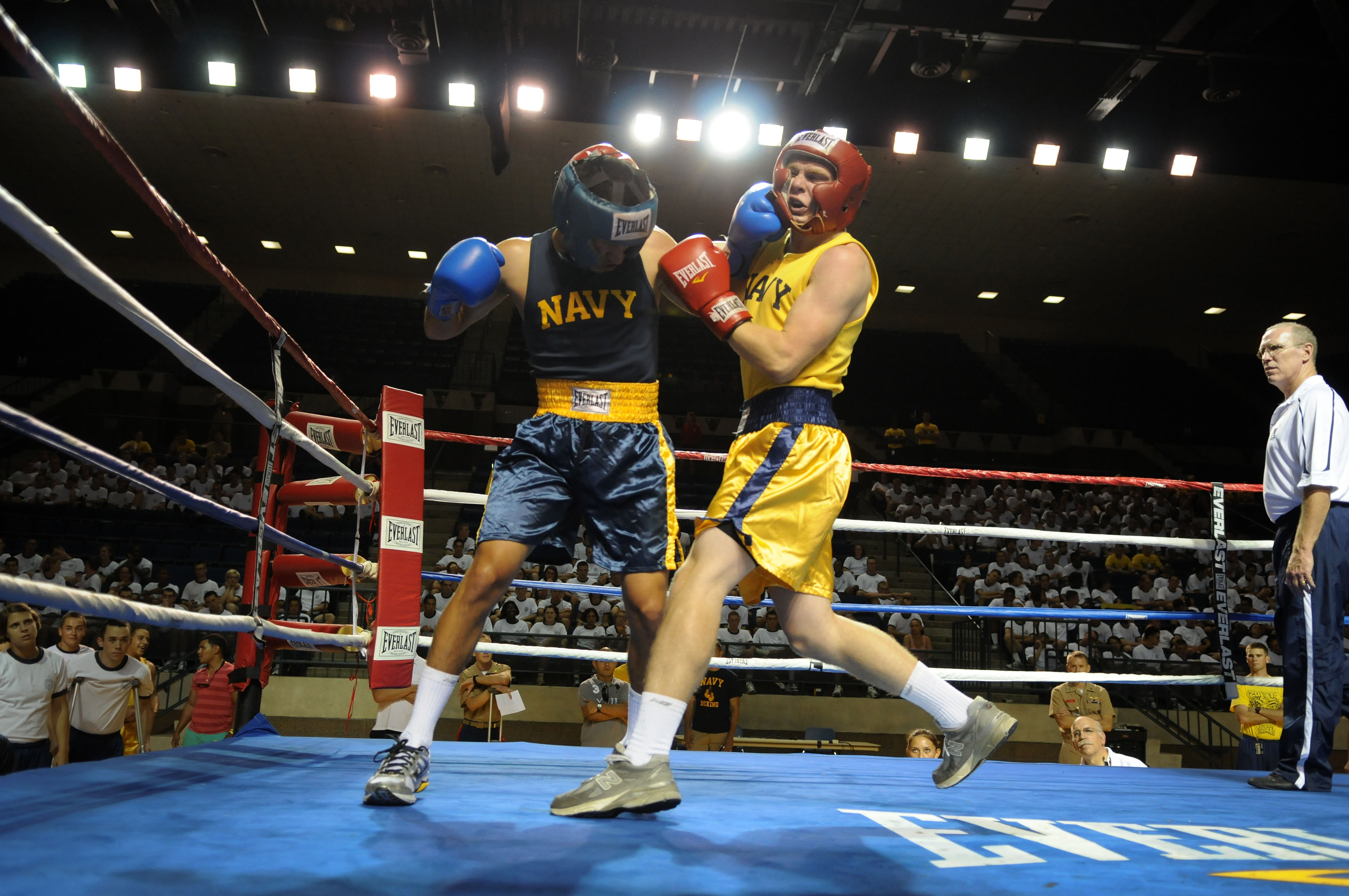 120804-N-OA833-006 ANNAPOLIS, Md. (Aug. 4, 2012) U.S. Naval Academy Midshipman 4th Class Mario Kohn, left, connects with a punch during the 147 lb. weight class bout of the annual Plebe Boxing Smoker held in Alumni Hall. Every plebe receives an introduction to boxing during plebe summer training. Plebe summer is a physically and mentally demanding six-week process designed to transition the new class of students from civilian to midshipman life. (U.S. Navy photo by Mass Communication Specialist 1st Class Chad Runge/Released)